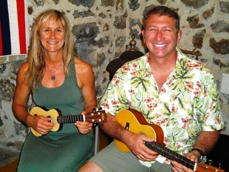 Emma and Peter take lessons from Ukulele Mele