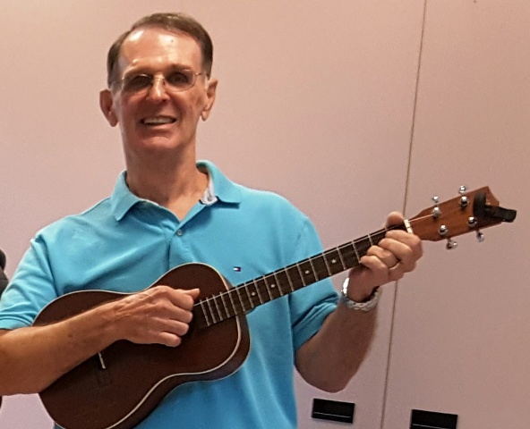 Kip takes lessons from Ukulele Mele