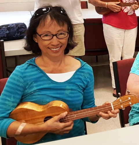 Lee Ann takes lessons from Ukulele Mele